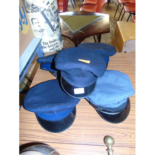 14 - A selection of five military hats...