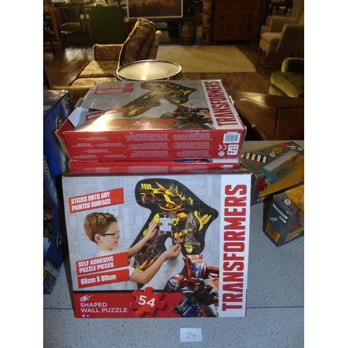 24 - Six new boxed Transformer self adhesive wall puzzles...