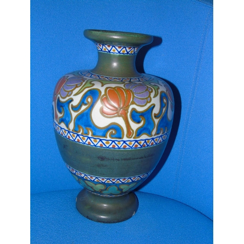 28 - A Gouda Crocus pattern vase (chip to the foot) 31cm tall...