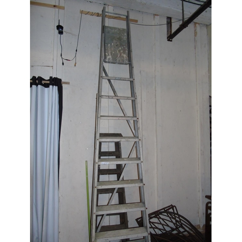 52 - A large set of aluminum step ladders...