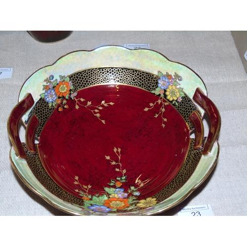 23 - A hand decorated crown Devon lustre bowl....