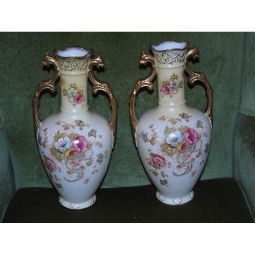 24 - A pair of Crown Devon blush ivory vases. 32cm tall...
