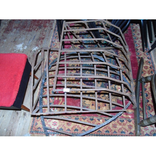 54 - A selection of cast iron wall mounted cattle feeders....