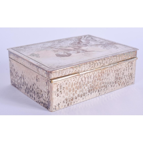 769 - AN ART DECO SILVER PLATED COPPER BOX AND COVER decorated with hounds. 10 cm x 7.5 cm....