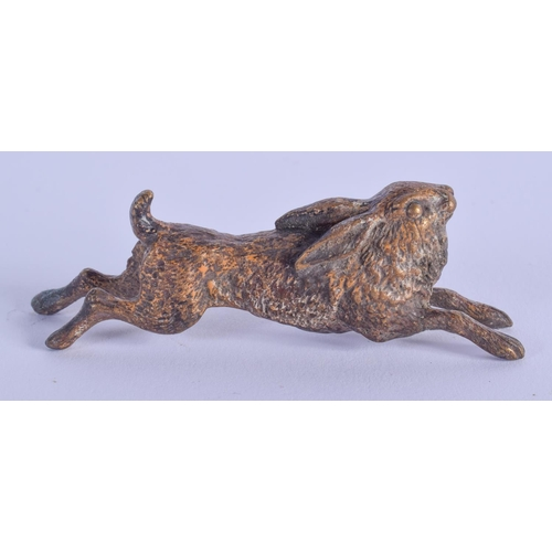 772 - A COLD PAINTED BRONZE HARE. 7 cm wide....