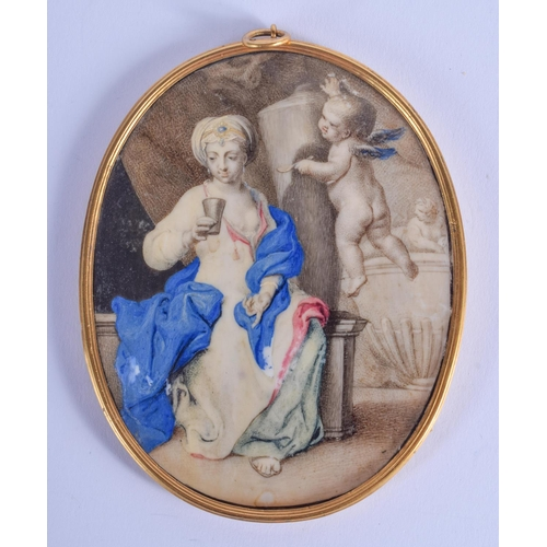 775 - AN 18TH CENTURY CONTINENTAL IVORY PIQUE WORK MINIATURE painted with a cherub and female within a tem...