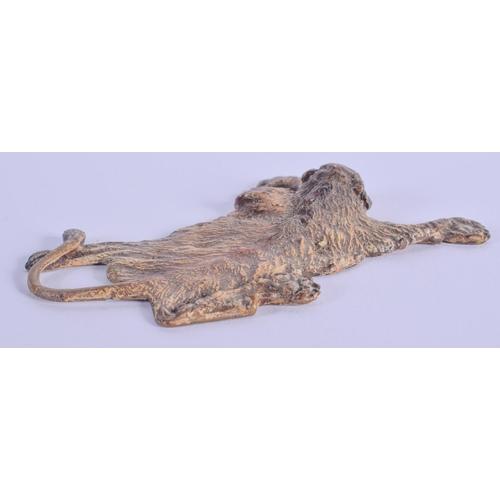 779 - A COLD PAINTED BRONZE LION RUG. 8 cm x 6 cm....