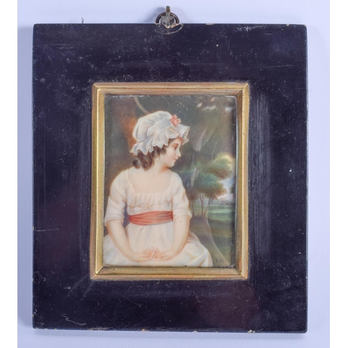 783 - AN ANTIQUE CONTINENTAL PAINTED IVORY PORTRAIT MINIATURE by Pitt, depicting a female wearing a bonnet...