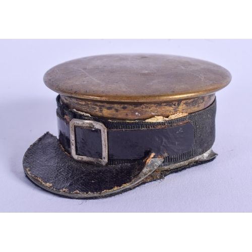 802 - A RARE ANTIQUE MILITARY BRASS HAT INKWELL. 6 cm x 4 cm....