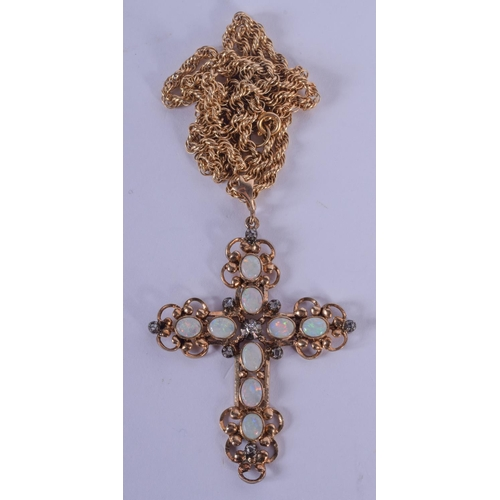 1005 - AN ANTIQUE 9CT GOLD AND OPAL PENDANT with 9ct gold chain. 15 cm long....