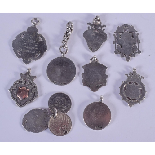 1010 - NINE ANTIQUE SILVER WATCH FOBS. (9)...