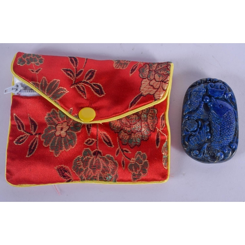1012 - A CHINESE LAPIS PLAQUE within a purse. 5.5 cm x 3.5 cm....