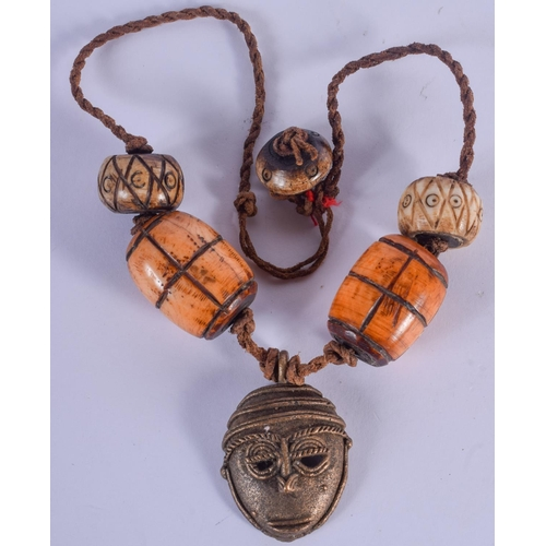 1024 - AN UNUSUAL TRIBAL BRONZE AND BONE NECKLACE. 40 cm long....
