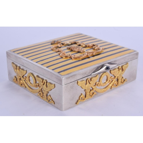 1028 - A CONTINENTAL TIGERS EYE ENAMELLED SILVER BOX decorated in raised silver gilt with helmets and folia...