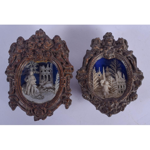 1039 - A RARE PAIR OF 18TH/19TH CENTURY CONTINENTAL CARVED WOOD DIORAMAS decorated with figures. 13 cm x 19...
