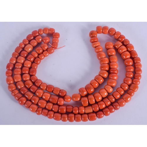 1048 - A LONG 18CT GOLD AND CORAL NECKLACE. 231 grams. 30 cm long....