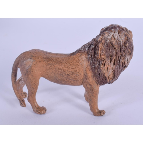 1054 - A CONTEMPORARY COLD PAINTED BRONZE LION. 9.5 cm wide....