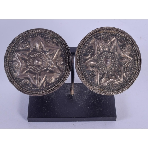 1094 - A PAIR OF EARLY MIDDLE EASTERN SILVER BUCKLES. 4.5 cm wide....