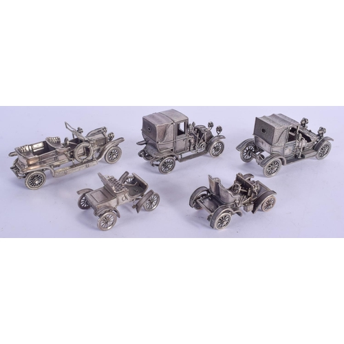 1107 - A LOVELY SET OF CONTINENTAL SILVER MODELS OF CARS modelled as classical vehicles. 759 grams. Largest...