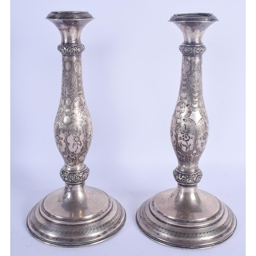 1113 - A LARGE PAIR OF 19TH CENTURY CONTINENTAL SILVER CANDLESTICKS decorated with foliage. 637 grams. 31 c...