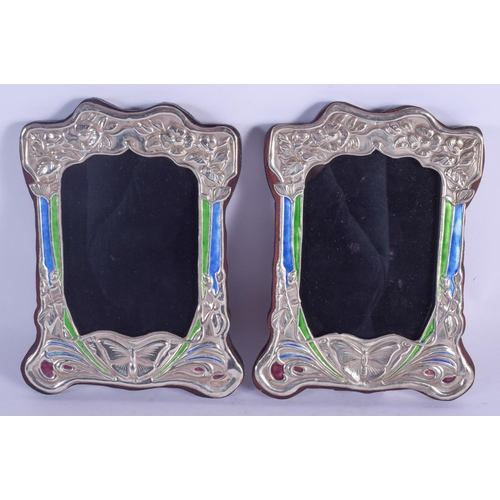 1137 - A PAIR OF SILVER AND ENAMEL PHOTOGRAPH FRAMES. 19 cm x 14 cm....