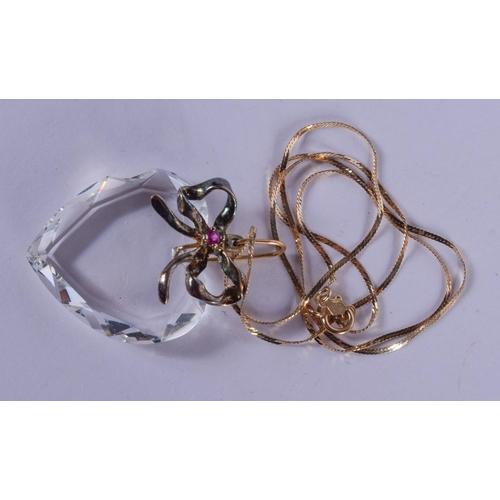 1151 - A GOLD MOUNTED ENAMELLED CRYSTAL GLASS PENDANT. 10 grams. 48 cm long, pendant 3 cm x 3 cm....