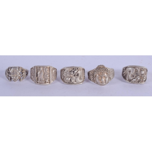 1158 - FOUR CHINESE RINGS. (4)...