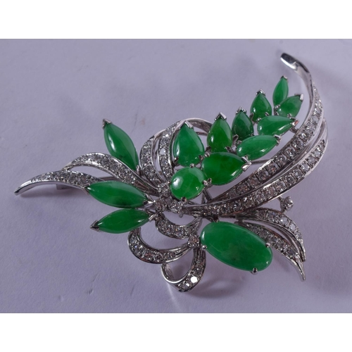 1181 - AN 18CT GOLD DIAMOND AND JADE BROOCH of floral form. 16 grams. 6 cm x 5 cm....