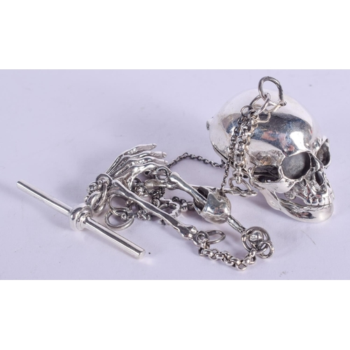 1183 - A SILVER SKULL NECKLACE on chain. 54 grams. 31 cm long....