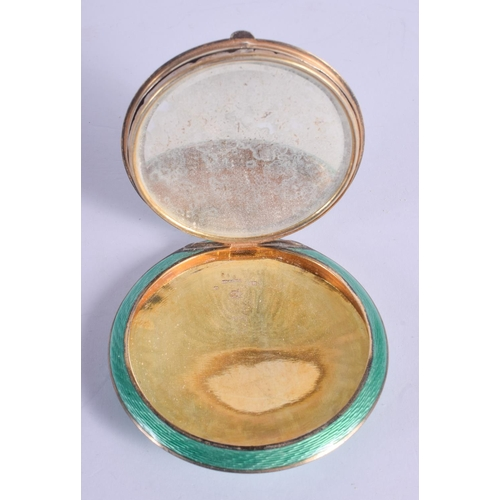 1198 - AN ART DECO SILVER AND ENAMEL BIRD COMPACT. 119 grams. 8.5 cm diameter....