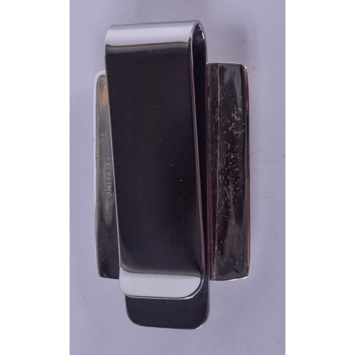 1213 - A SILVER EROTIC MONEY CLIP. 22 grams. 5 cm x 3 cm....