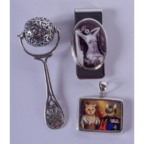 1218 - A SILVER RATTLE and a silver money clip & a silver cat pendant. (3)...