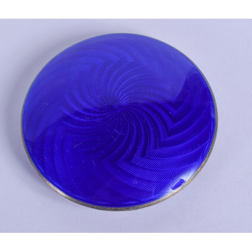1253 - AN ANTIQUE SILVER AND ENAMEL COMPACT. 66 grams. 6 cm diameter....