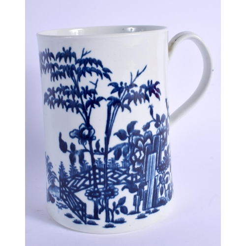 126 - A 18TH C. WORCESTER FINE MUG printed with a fence and bamboo, the reverse with swimming ducks in fro...