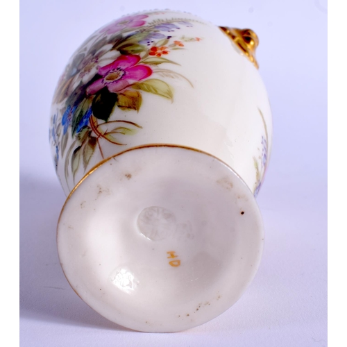146 - Royal Worcester over handled vase painted with heather by impress mark. 12.5cm high....