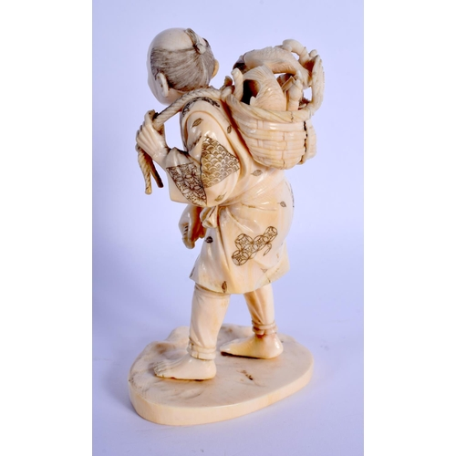 1507 - A 19TH CENTURY JAPANESE MEIJI PERIOD CARVED IVORY OKIMONO modelled as a roaming fisherman. 13.5 cm h...
