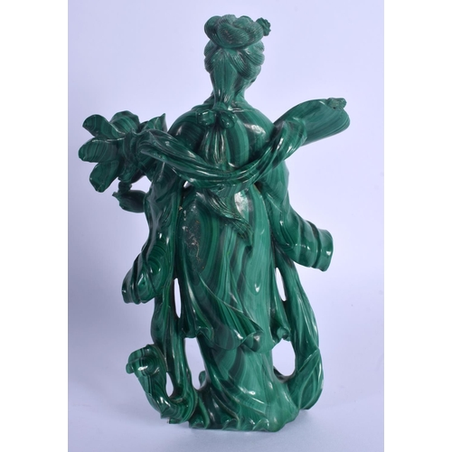 1513 - AN EARLY 20TH CENTURY CHINESE CARVED MALACHITE FIGURE OF GUANYIN Late Qing, modelled holding floral ...
