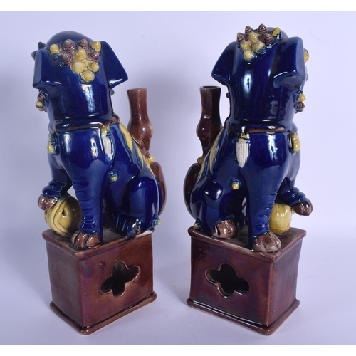 1518 - A PAIR OF 19TH CENTURY CHINESE BLUE GLAZED BUDDHISTIC DOGS OF FOE Qing, modelled upon a brown glazed...