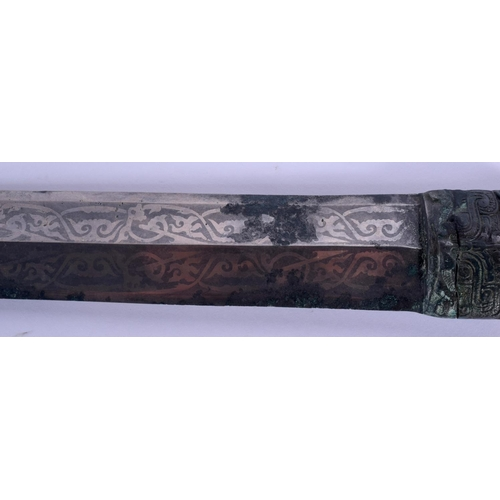 1519 - AN EXTREMELY RARE EARLY CHINESE BRONZE HANDLED SWORD Shang or Zhou Dynasty, decorated with taotie ma...