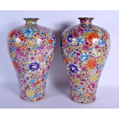 1520 - A PAIR OF CHINESE FAMILLE ROSE BALUSTER PORCELAIN VASES 20th Century, painted with flowers. 38 cm hi...