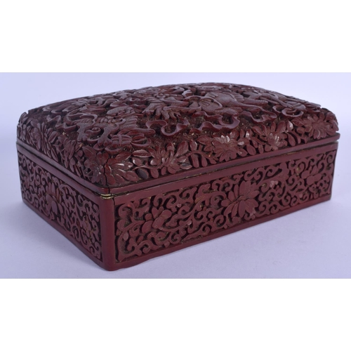 1536 - A RARE 19TH CENTURY CHINESE CARVED CINNABAR LACQUER BOX AND COVER Qing, unusually decorated with bud...