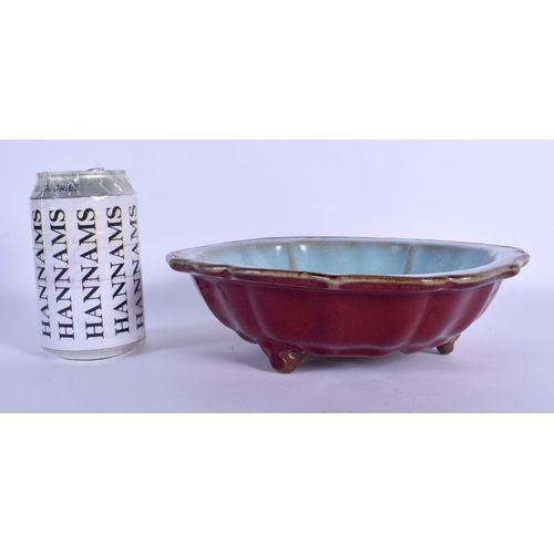 1549 - A CHINESE JUNYAO GLAZED STONEWARE CENSER 20th Century, of barbed form. 21 cm wide....