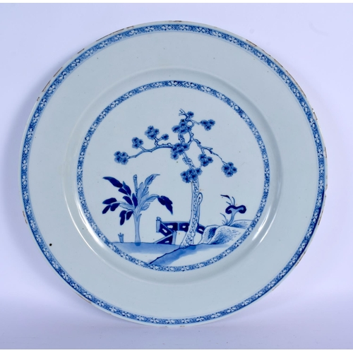 1550 - A LARGE 18TH CENTURY CHINESE BLUE AND WHITE PORCELAIN DISH Yongzheng/Qianlong, painted with a fenced...