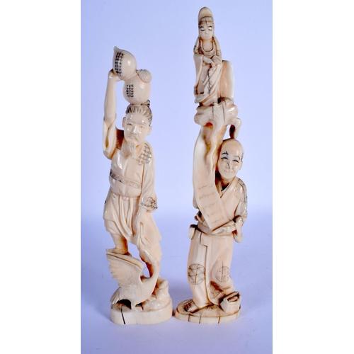 1561 - TWO 19TH CENTURY JAPANESE MEIJI PERIOD CARVED IVORY OKIMONO modelled holding aloft figures and fruit...