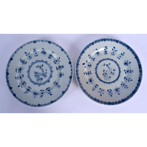 1565 - A PAIR OF EARLY 18TH CENTURY CHINESE BLUE AND WHITE PLATES Yongzheng/Qianlong, painted with floral s...