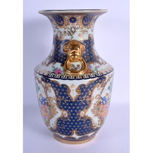 1567 - A CHINESE TWIN HANDLED PORCELAIN VASE 20th Century, decorated with European subjects. 36 cm x 19 cm....
