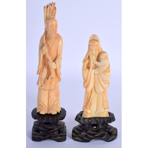 1568 - TWO 19TH CENTURY CHINESE CARVED IVORY FIGURES OF SCHOLARS upon fitted hardwood bases. Ivory 12 cm hi...
