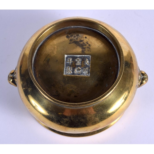 1589 - AN 18TH CENTURY CHINESE TWIN HANDLED BRONZE CENSER Qing, bearing Xuande marks to base, with mask hea...