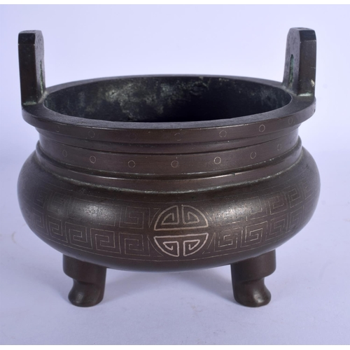 1597 - A 19TH CENTURY CHINESE TWIN HANDLED BRONZE CENSER Qing, silver inlaid with shou characters. 887 gram...