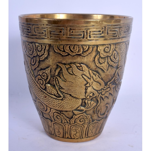 1599 - A 19TH CENTURY CHINESE BRONZE BEAKER FORM VASE Qing, decorated with dragons. 11 cm high....